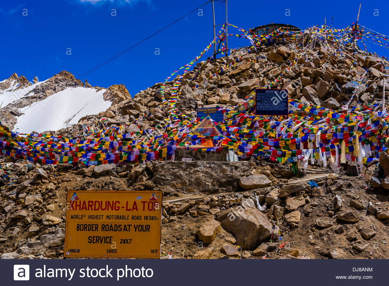Prayer flags on the summit of Khardungla Pass. At 18,379 feet, the pass is  the highest motorable road in the world. Ladakh, Jammu and Kashmir State,  India.