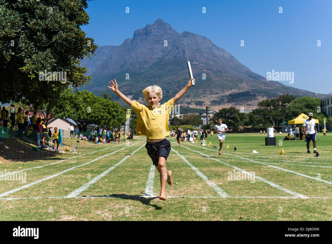 Winner of the relay race crosses the finishing line, St Georges School, Cape Town, South Africa - Stock Image