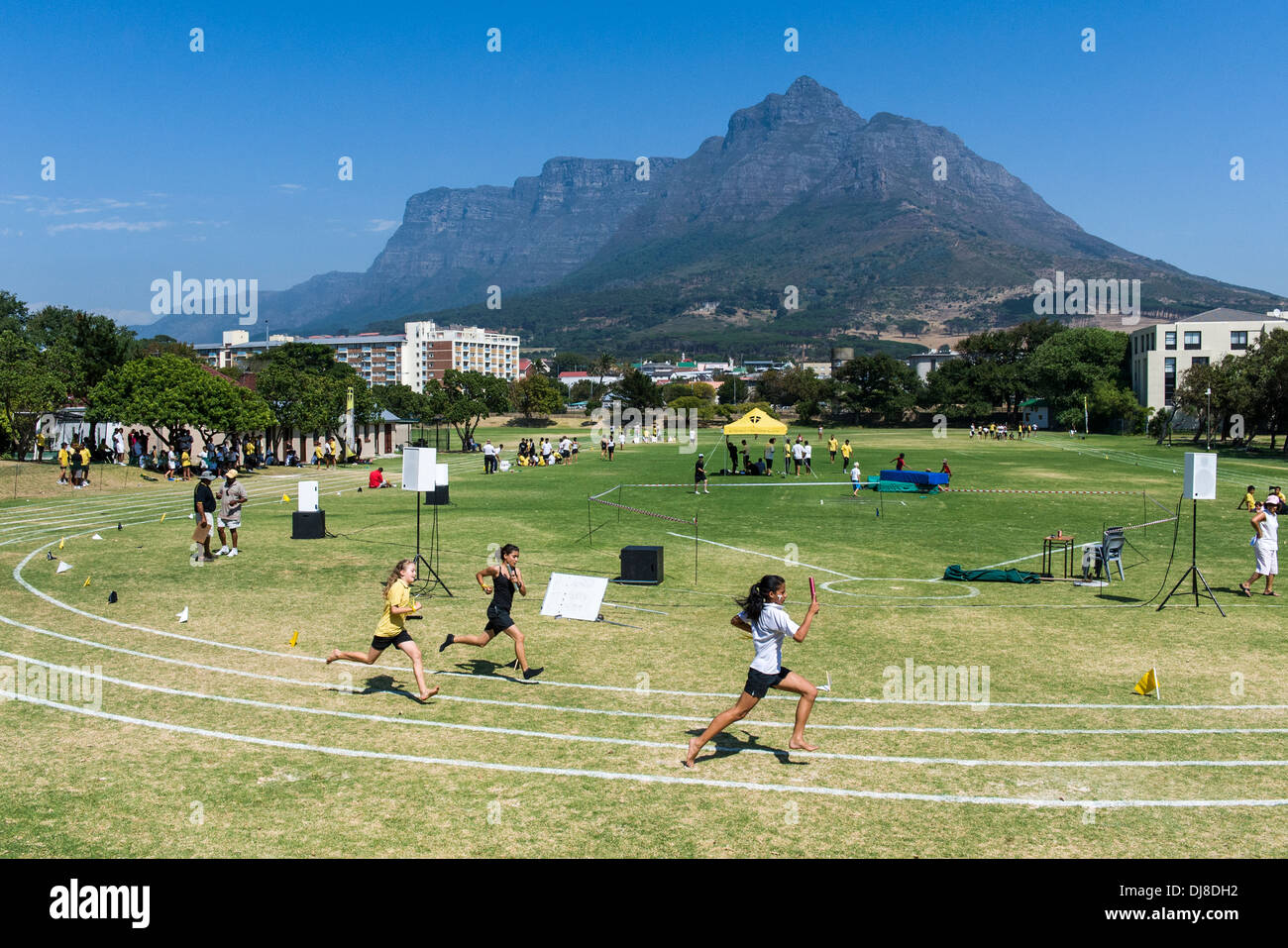 Girls running relay race, St Georges School, Cape Town, South Africa - Stock Image