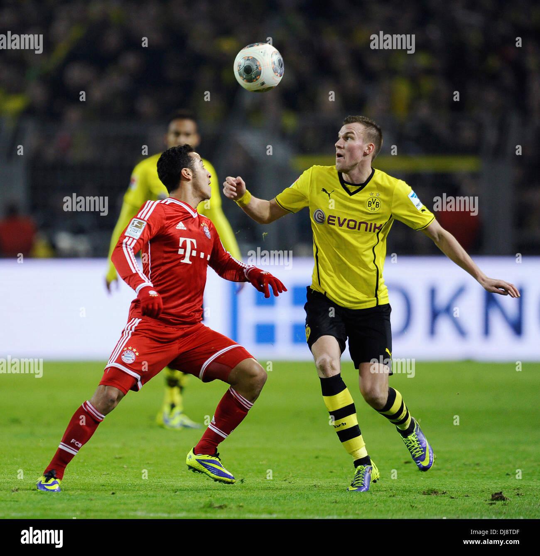 Dortmund, Germany November 23rd 2013, German Football Bundesliga Season 2013/14 matchday 13, Borussia Dortmund (BVB) vs.  FC Bayern Munich (Muenchen, Munchen, FCB) 3:0 --- Thiago Alcantara (Bayern) and Kevin Gro§kreutz (Grosskreutz) (BVB) - Stock Image