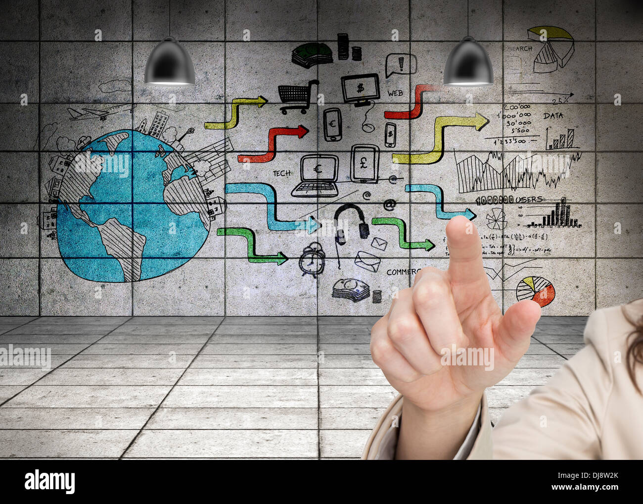 Womans hand pointing against wall background showing global business development - Stock Image