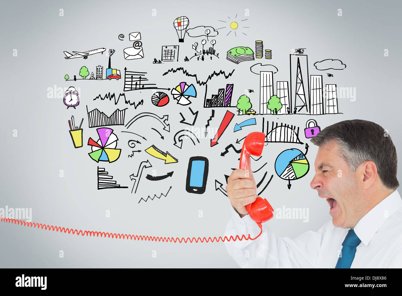 Businessman screaming directly into the handset - Stock Image