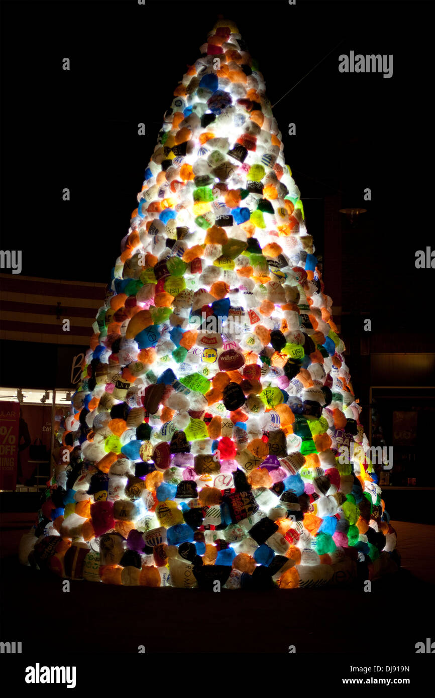 An illuminated Christmas tree, formed entirely from used plastic shopping bags, at the Durham Lumiere Festival, 2013. - Stock Image