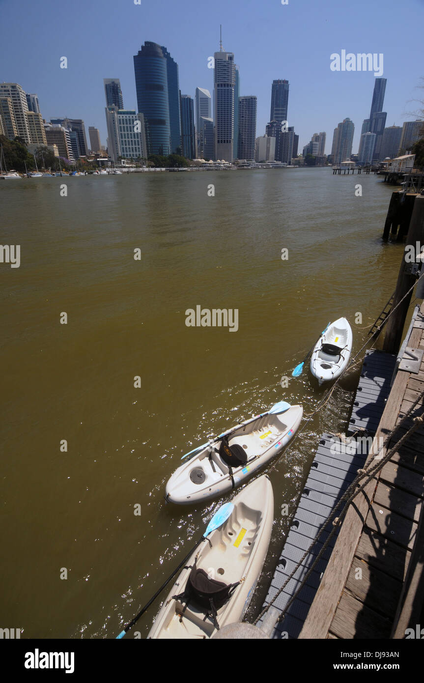 Kayaks on the Brisbane River with highrise CBD buildings in background, Brisbane, Queensland, Australia. No PR - Stock Image