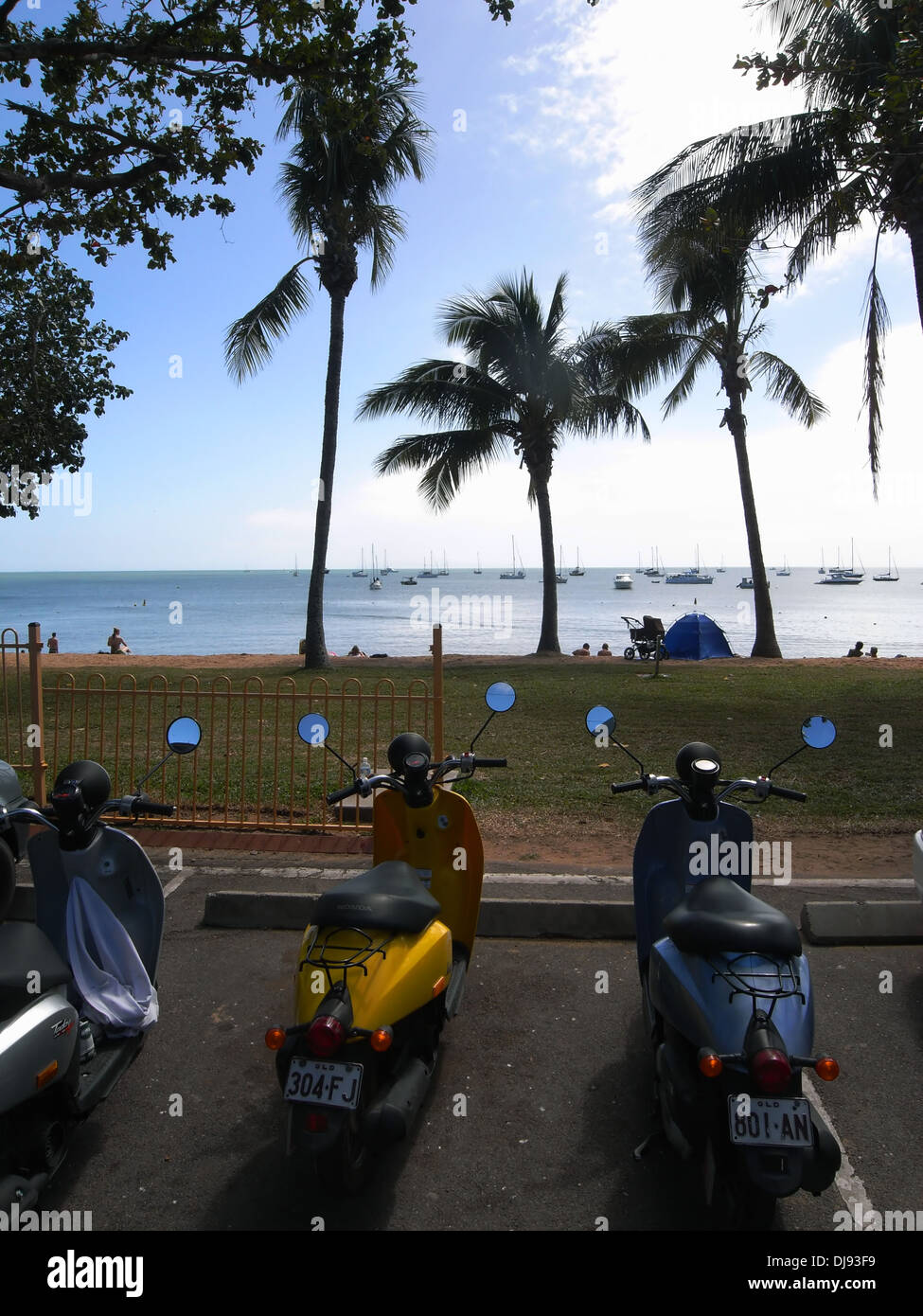 Mopeds parked on the foreshore at Horseshoe Bay, Magnetic Island, near Townsville, Queensland, Australia. No PR - Stock Image