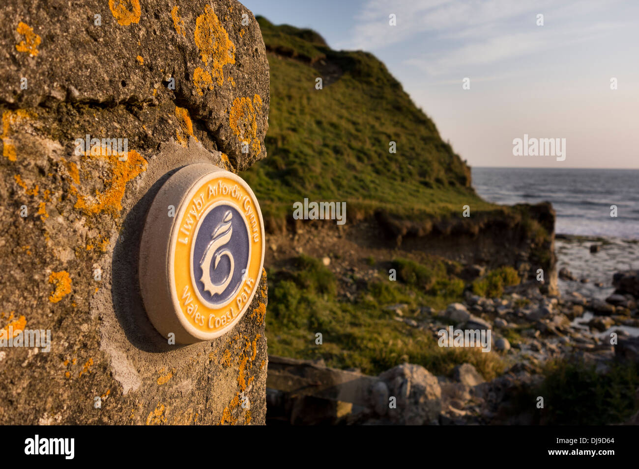 Wales Coast Path sign at the Glamorgan Heritage Coast near Monk Nash, Vale of Glamorgan, South Wales - Stock Image