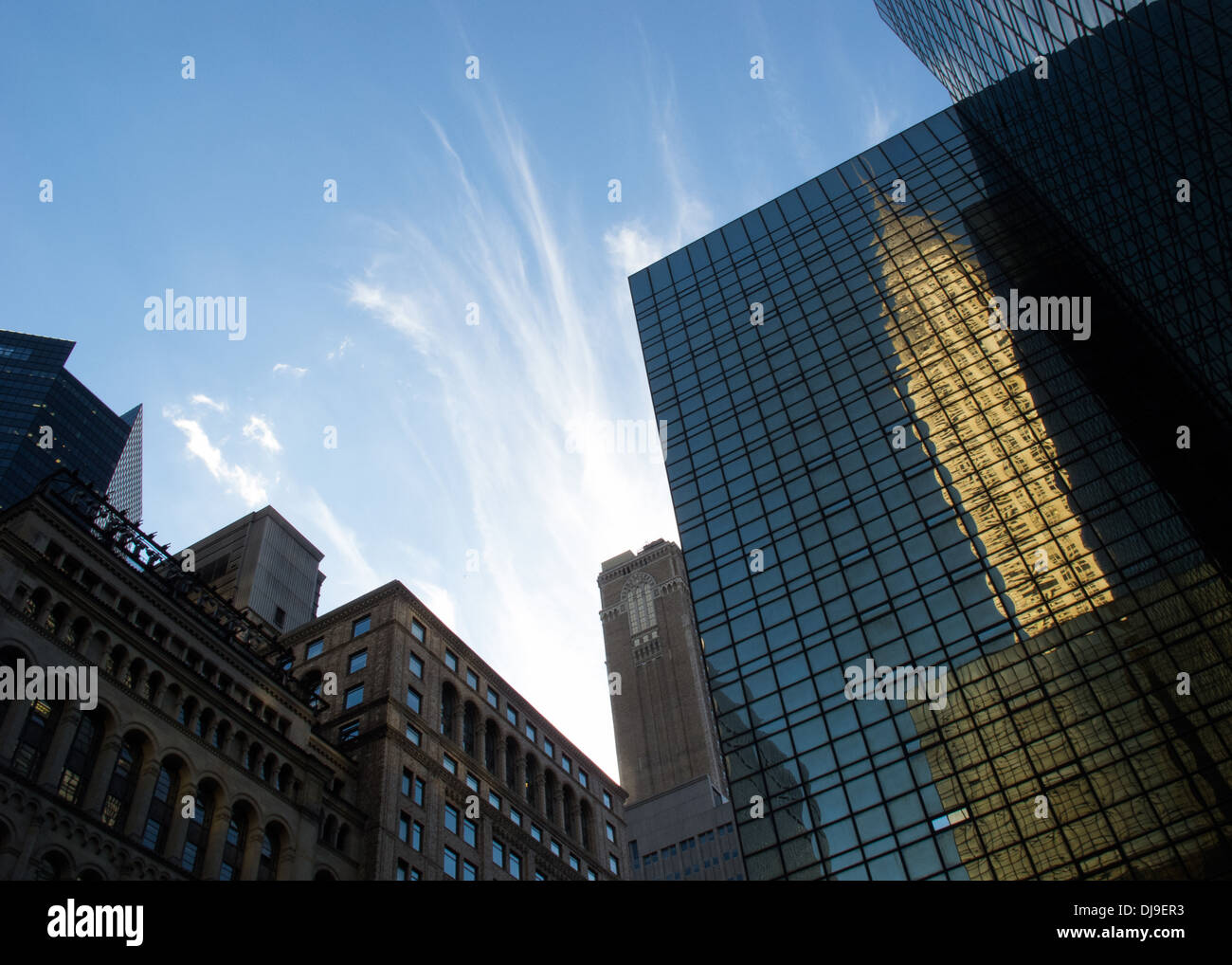 Glass facade with reflection of Chrysler building,Manhattan,New York,USA. - Stock Image