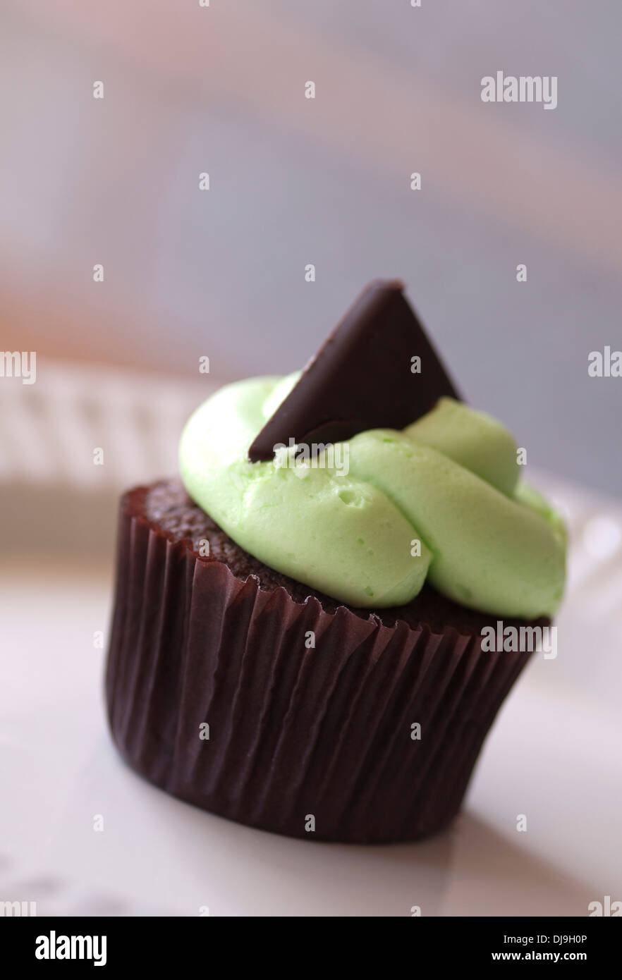 Still life food image of a cupcake with mint green fondant icing - Stock Image