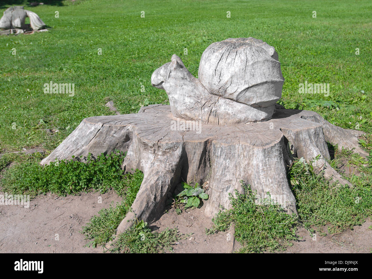 Veliky Novgorod. Snail on a tree stump. Carving - Stock Image