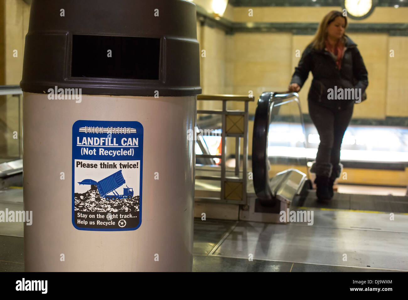 Chicago, Illinois - A sign on a trash can at Union Station urges recycling. - Stock Image