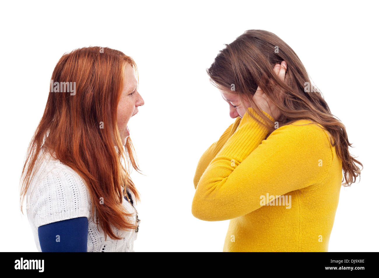 Screaming teens - angry girl screaming at her friend - isolated - Stock Image