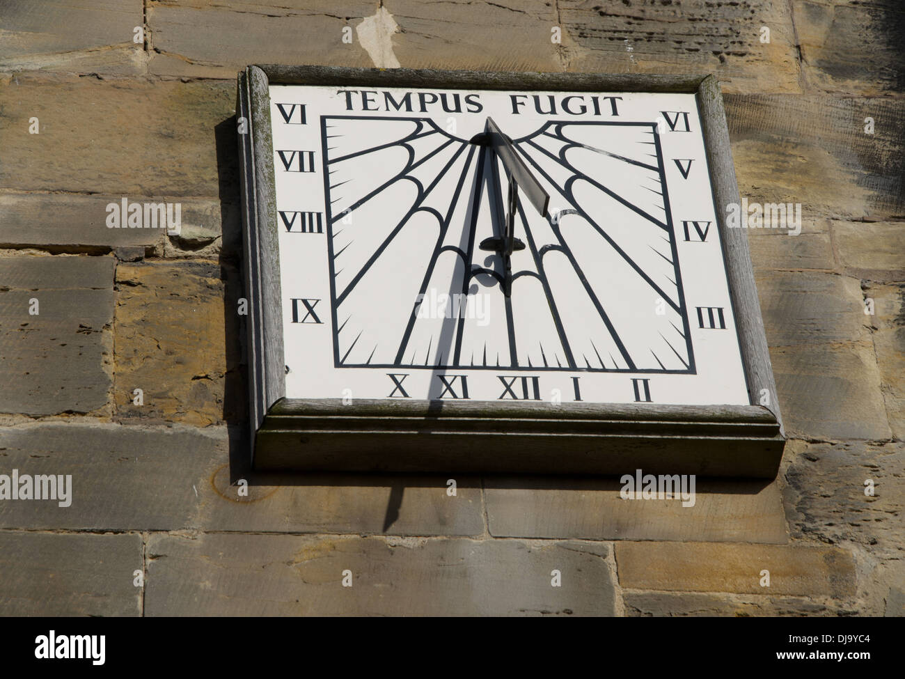 Wall mounted clock time flies - Stock Image