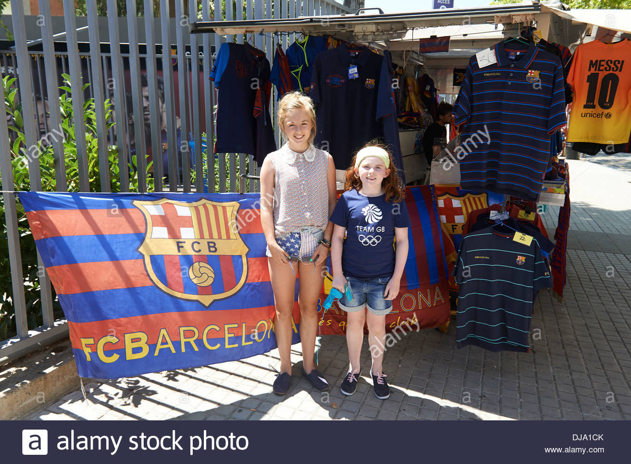 Young red haired girl posing at Shop outside Football Stadium in Barcelona in Catalunya in Spain in Europe - Stock Image
