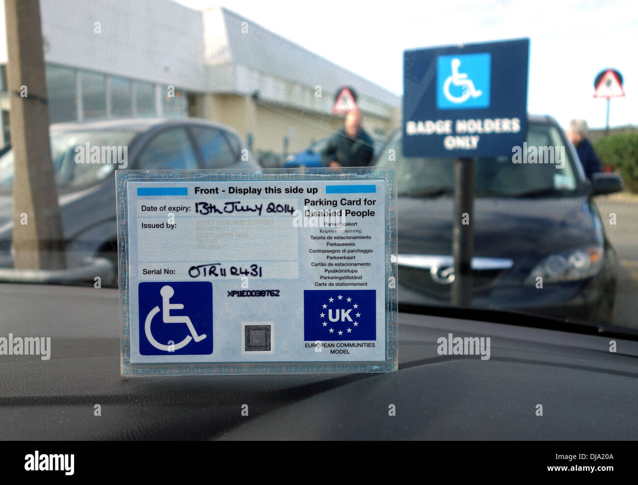 A blue badge disability parking permit Stock Photo