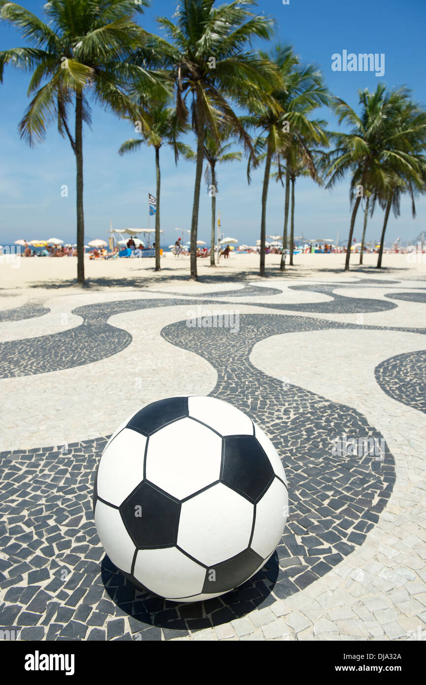 Football soccer ball sits on the boardwalk in Copacabana Rio de Janeiro Brazil - Stock Image
