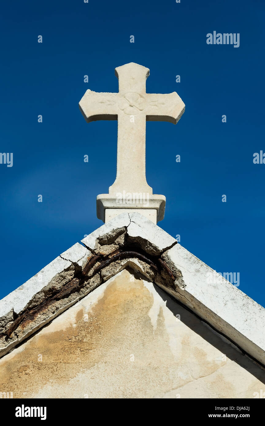Cross on a decaying mausoleum, St Tropez, France - Stock Image