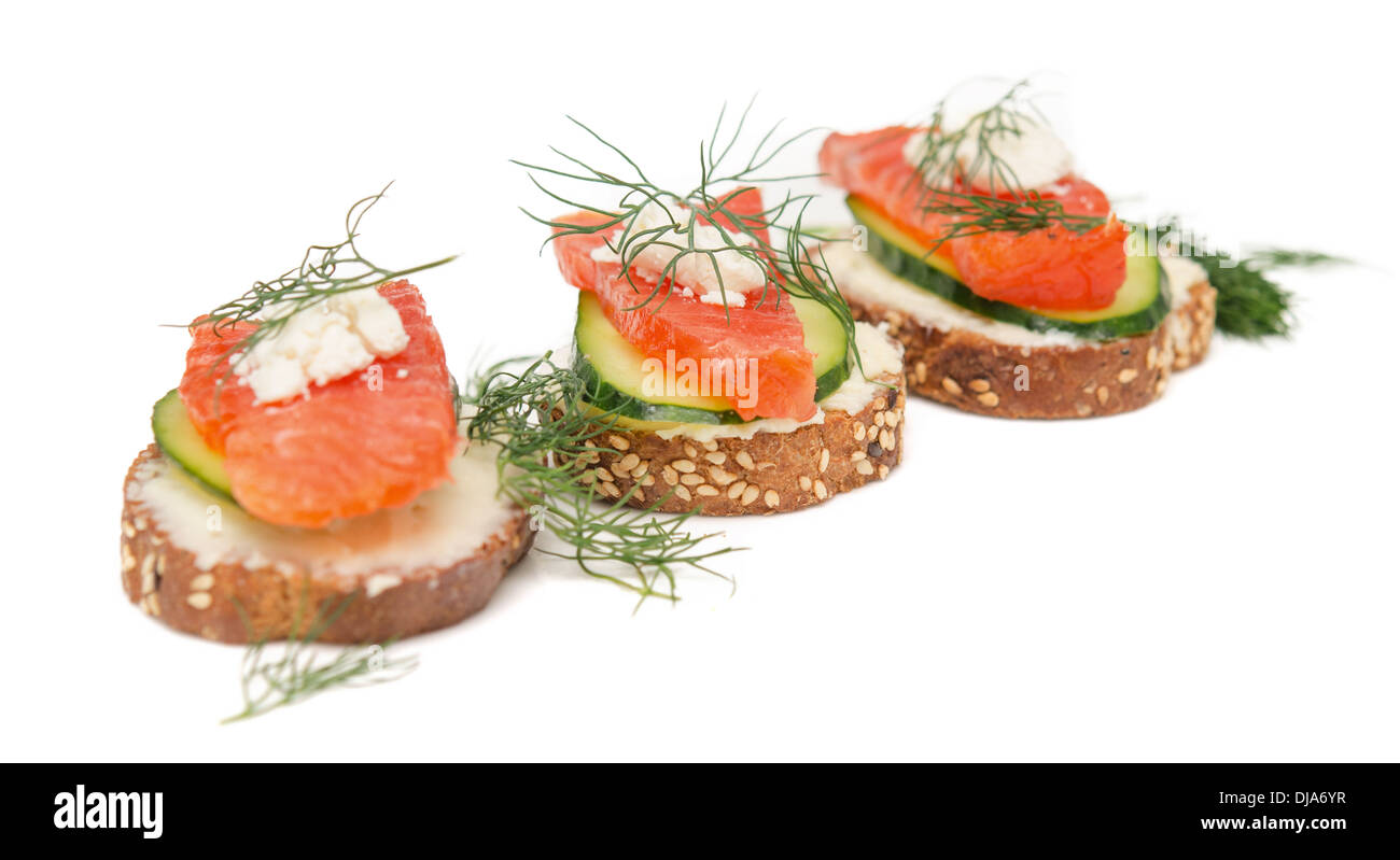 canapes with red fish on white background - Stock Image