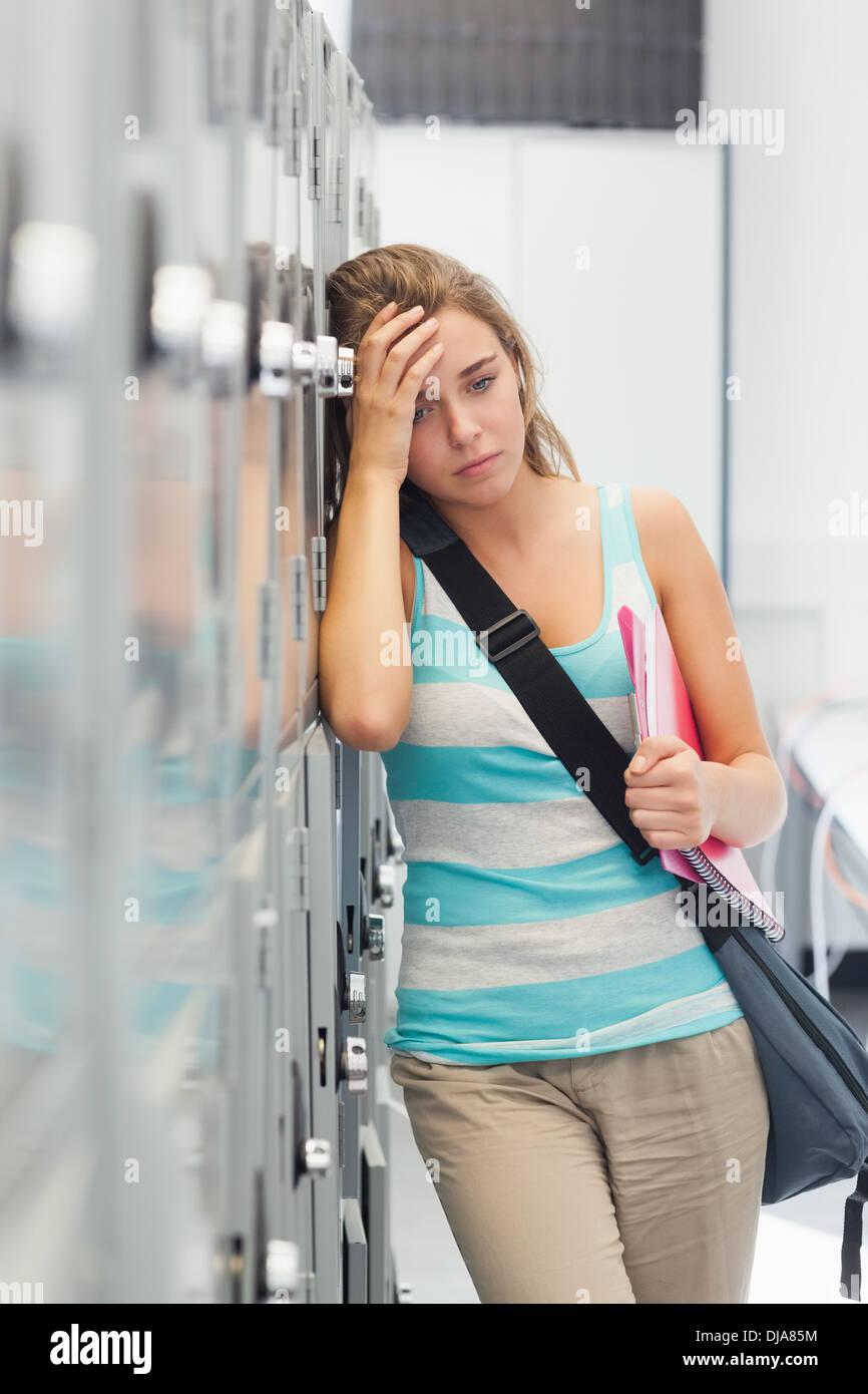 Grimacing pretty student having a headache - Stock Image