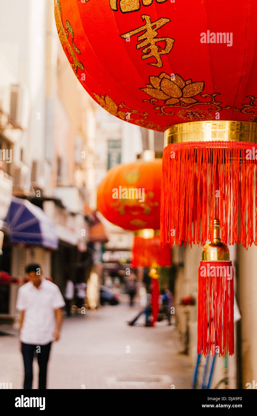 Chinese red lanterns adorn the walls of a street in Deira. Dubai, United Arab Emirates. - Stock Image