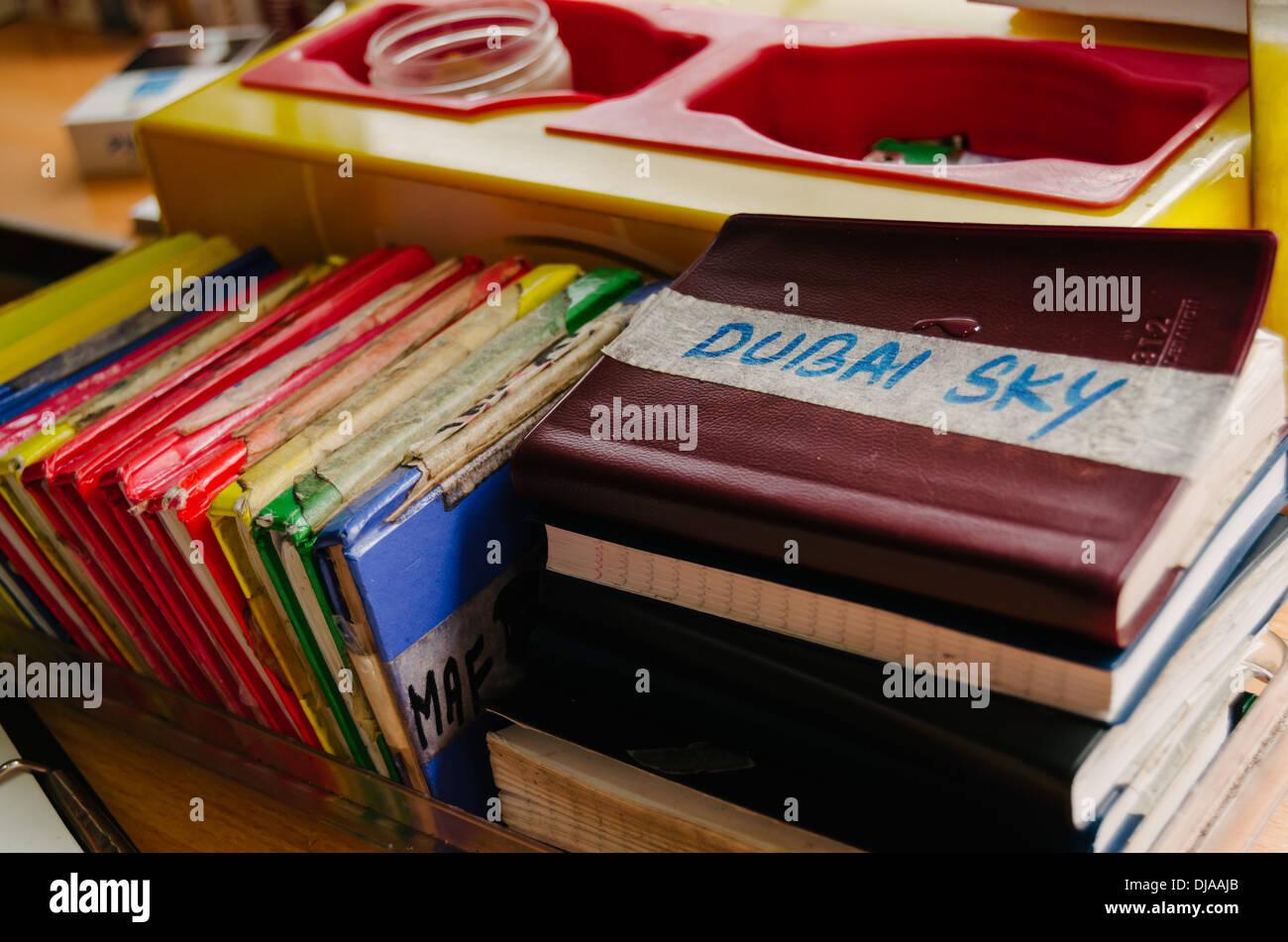Transaction notebooks inside store at Deira. Dubai, United Arab Emirates. - Stock Image