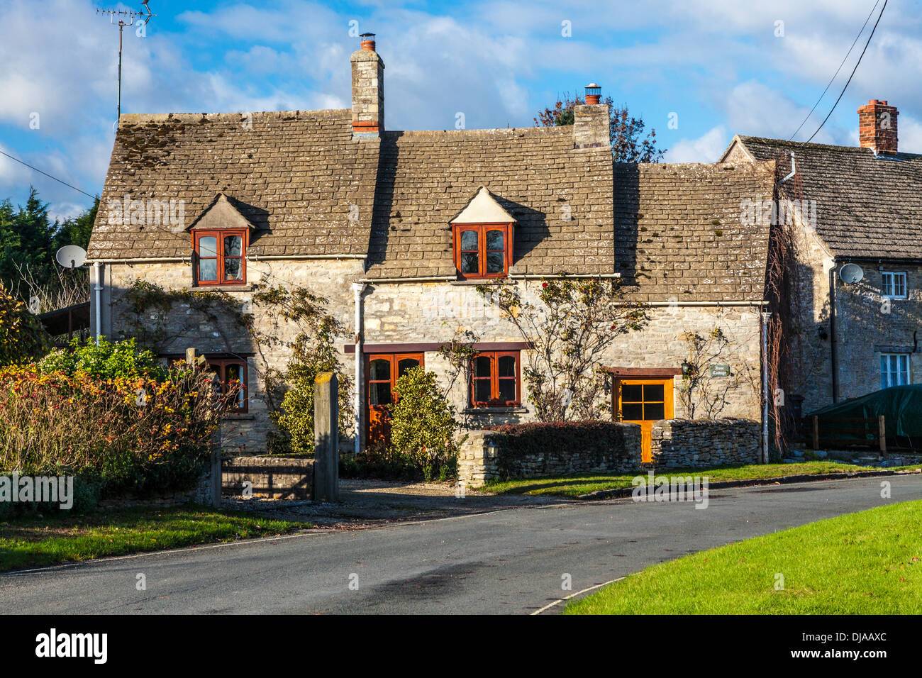 A pretty stone cottage in the Gloucestershire village of Dunfield. - Stock Image