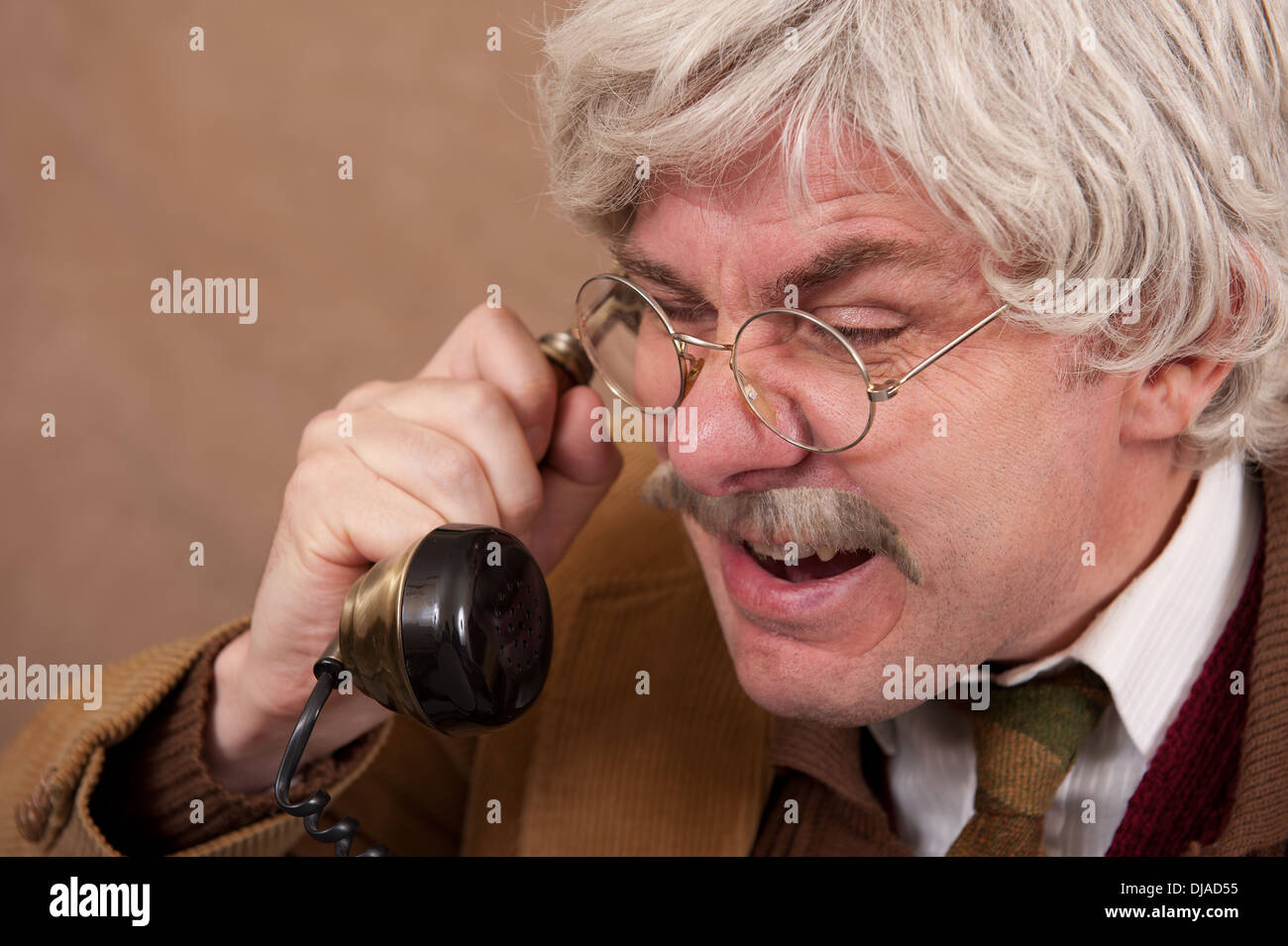 Angry Grey Haired Old Man Shouting Whilst On The Telephone Stock