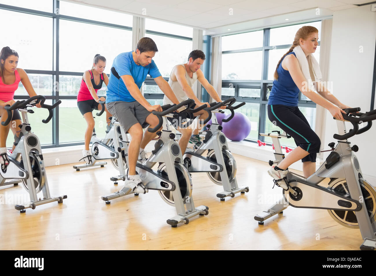 Determined people working out at spinning class Stock Photo