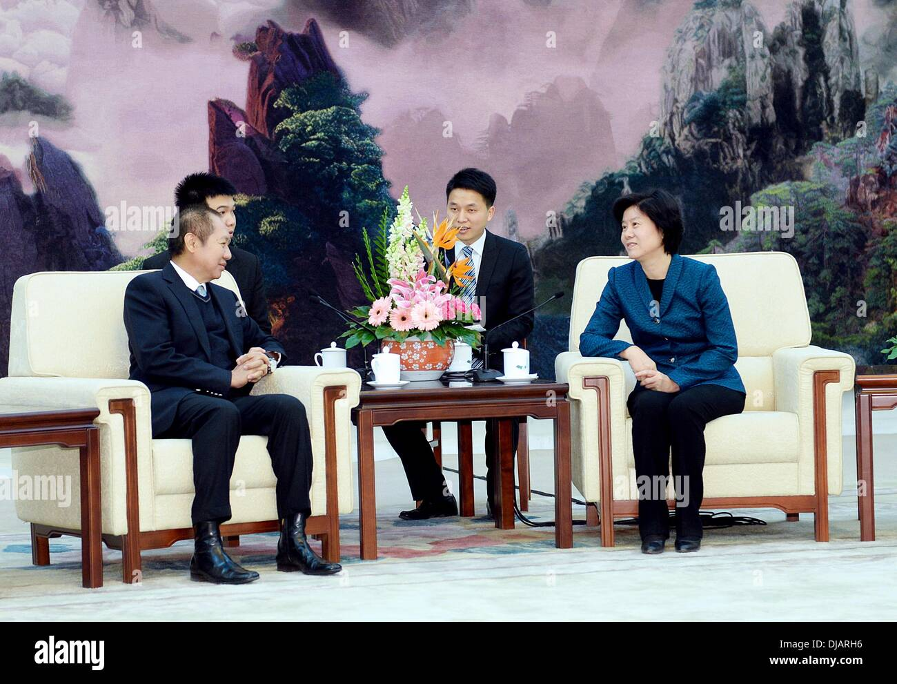 Beijing, China. 26th Nov, 2013. Shen Yueyue (R), vice chairwoman of the Standing Committee of the National People's Congress of China, meets with a Thai good-will delegation headed by Bhokin Bhalakula, president of the Thai-Chinese Culture and Economic Association, in Beijing, capital of China, Nov. 26, 2013. Credit:  Li Tao/Xinhua/Alamy Live News - Stock Image