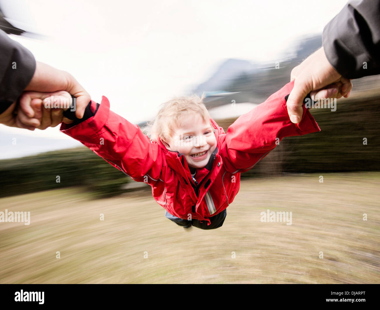 "Father letting his son ""fly"" Stock Photo"