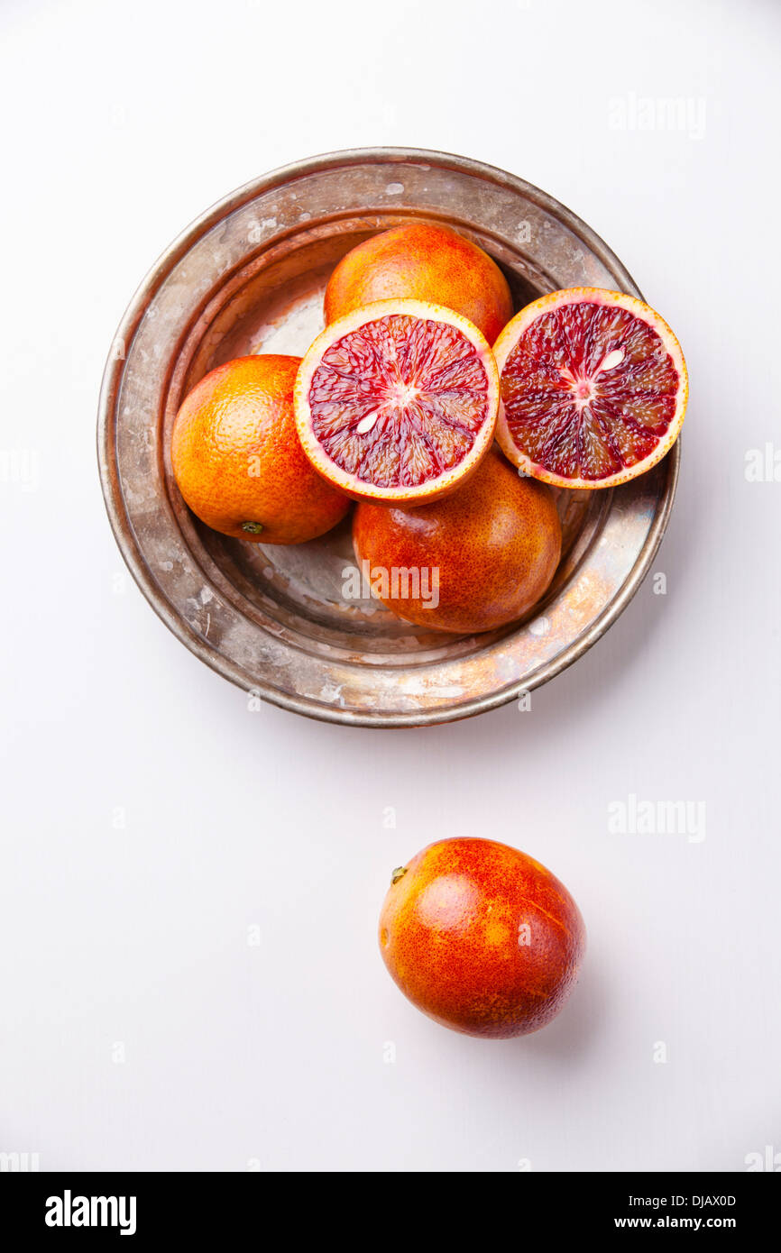 Ripe red oranges on white textured background - Stock Image