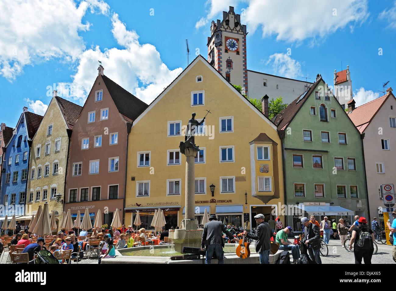 City fountain with the statue of Saint Magnus of Fuessen, Fuessen, Ostallgaeu, Allgaeu, Schwabia, Bavaria, Germany - Stock Image