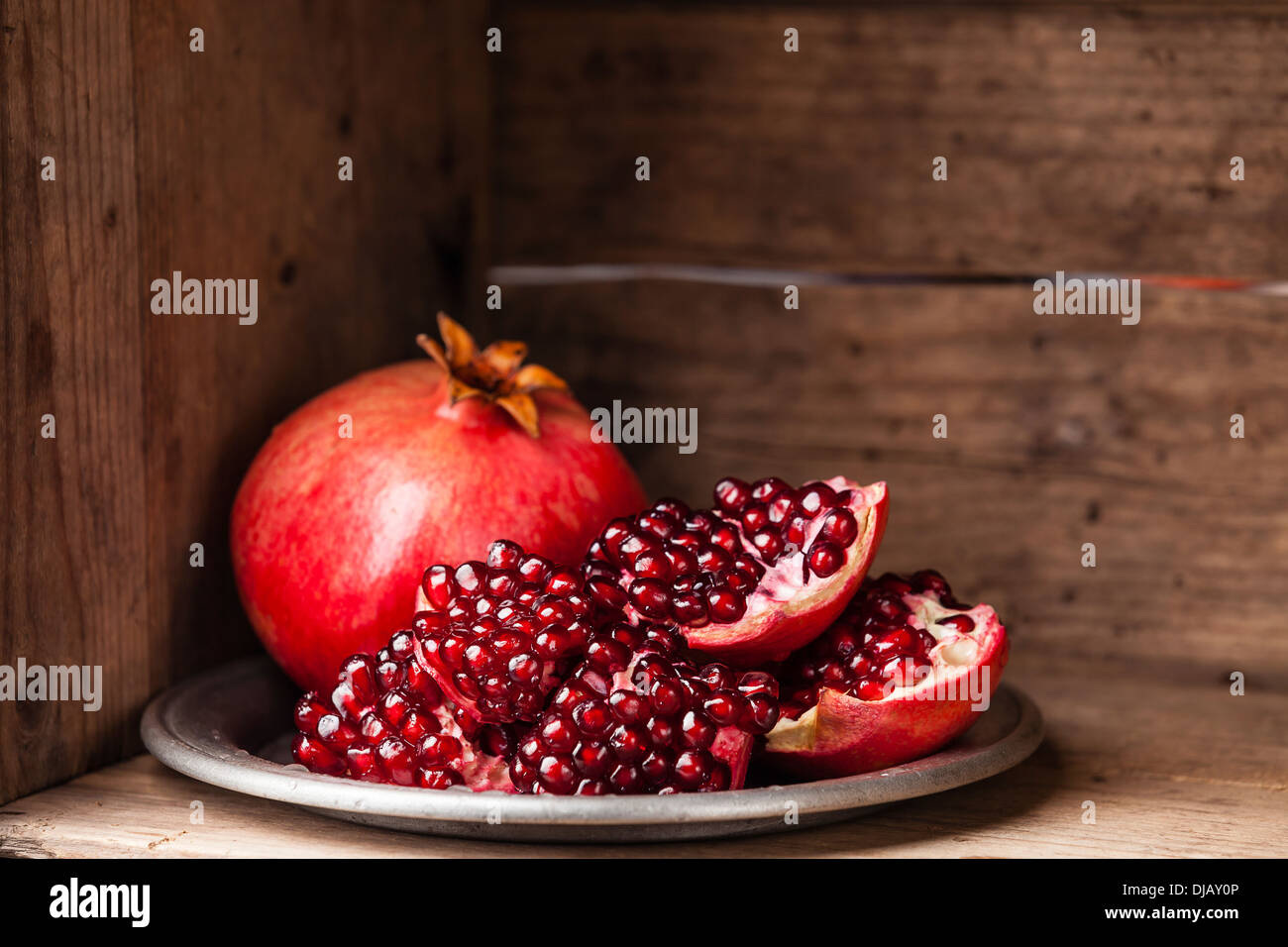 Pieces and seeds of ripe pomegranate - Stock Image
