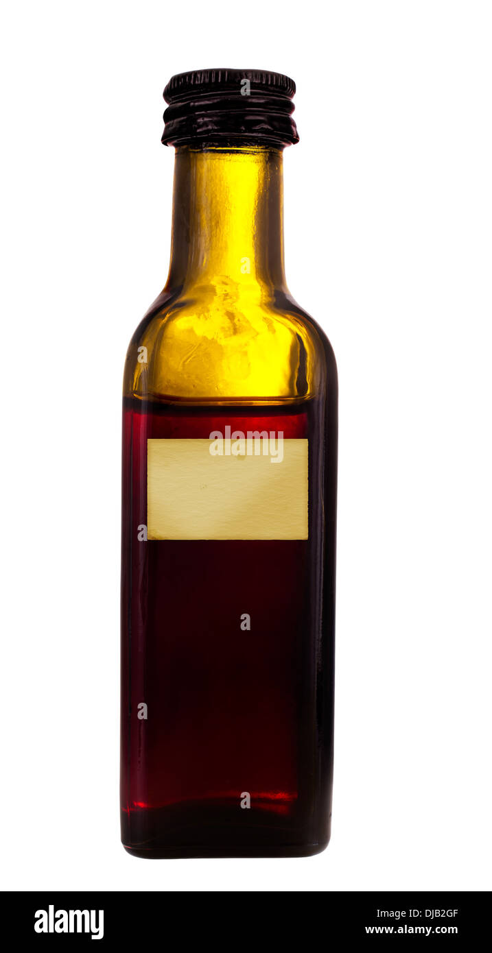 Old glass bottle.  Dubious looking contents. - Stock Image