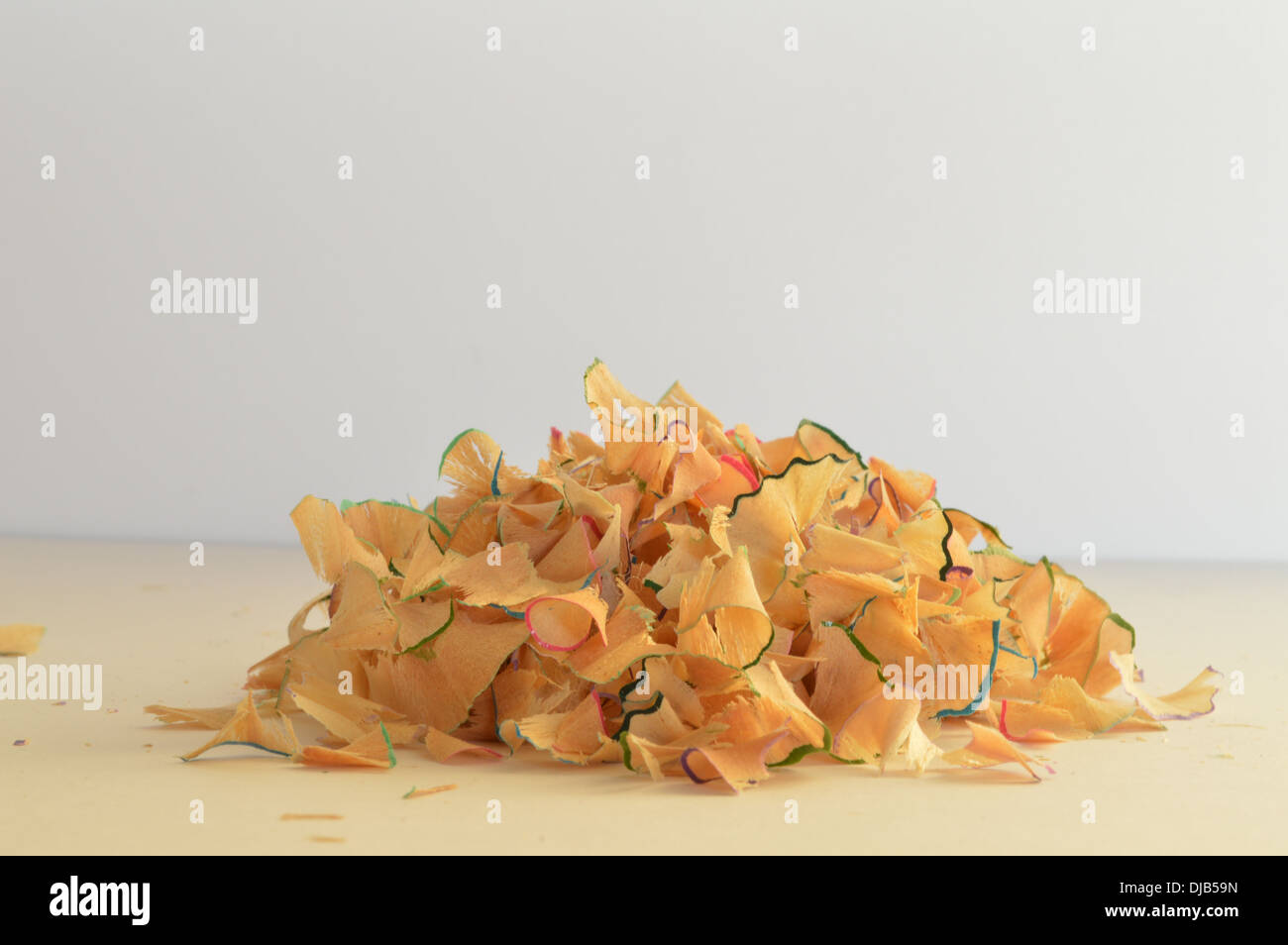 Pile of coloured pencil shavings, pile of coloured pencil sharpenings - Stock Image