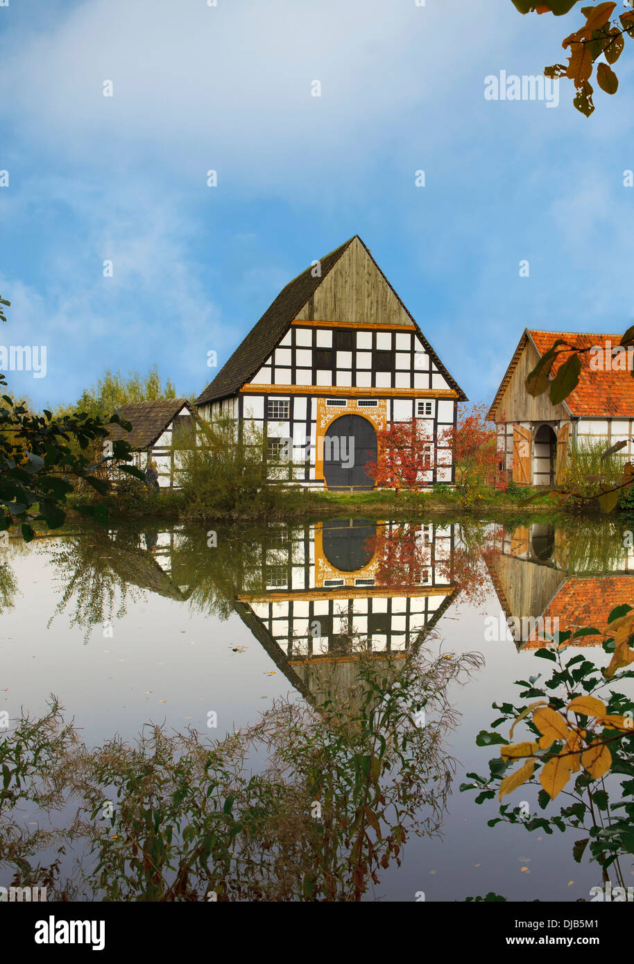 Village pond with an old half-timbered house from the 17th century, in autumn, Freilichtmuseum Detmold or Open-Air Museum - Stock Image