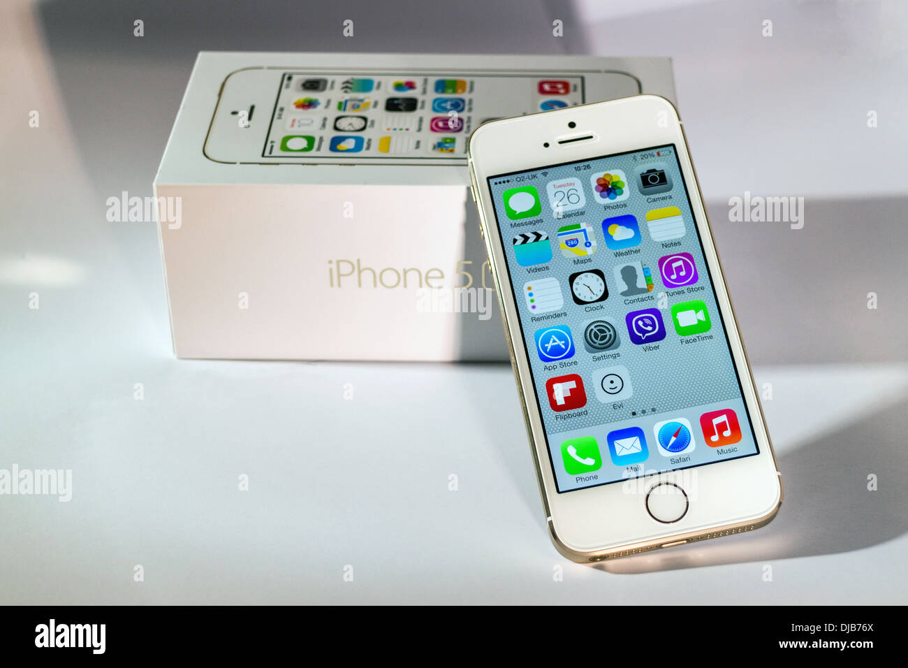 7d30cb893 iPhone 5s Gold Front View Slanted on Box With Shadows - Stock Image