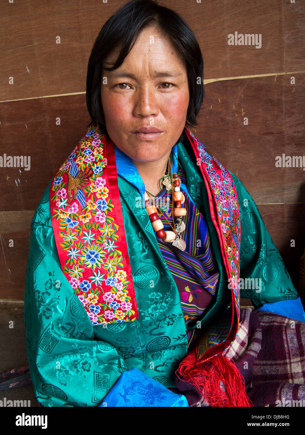 Bhutan, Phobjika, Gangte Goemba Tsechu, festival goer wearing traditional dress - Stock Image