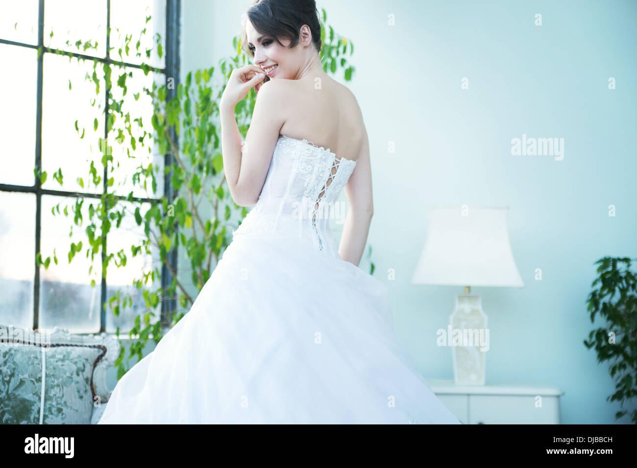 Tempting bride waiting for her beloved husband - Stock Image