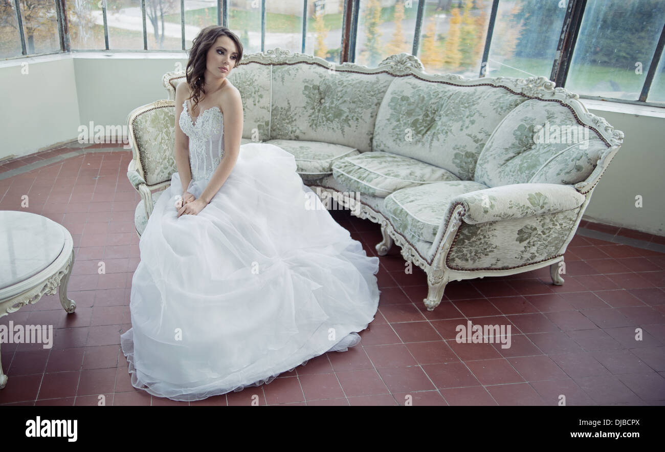 Stressed bride wearing pretty wedding gown - Stock Image
