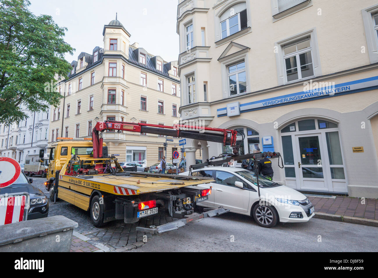 Germany, Bavaria, Munich, Illegally Parked Car being Removed Stock Photo