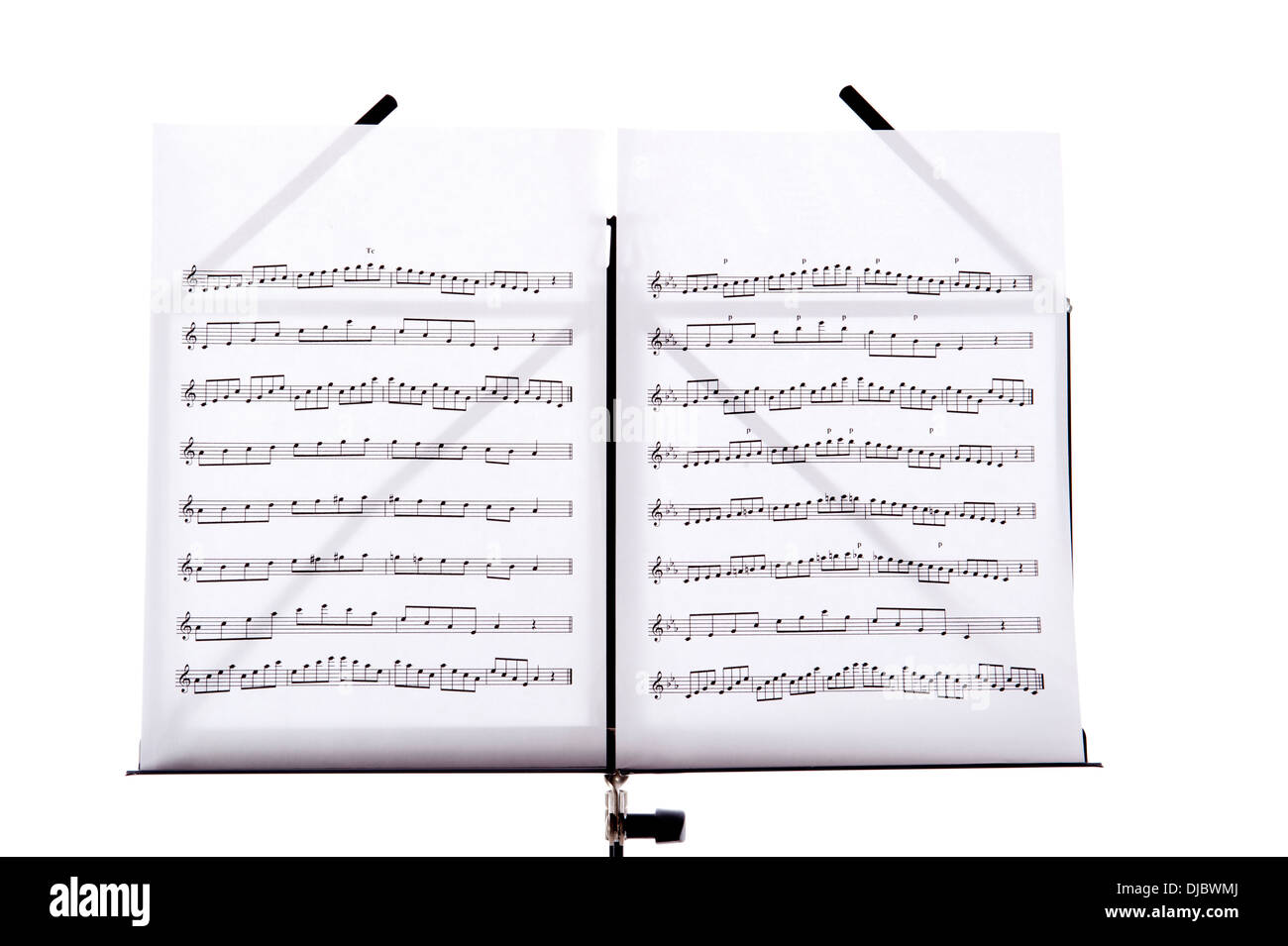 Melody sheets on a music sheet stand isolated in white - Stock Image