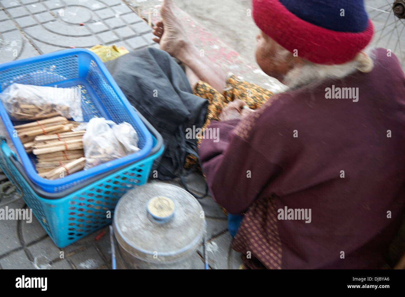 street market stall with customers in Korat, Thailand - Stock Image
