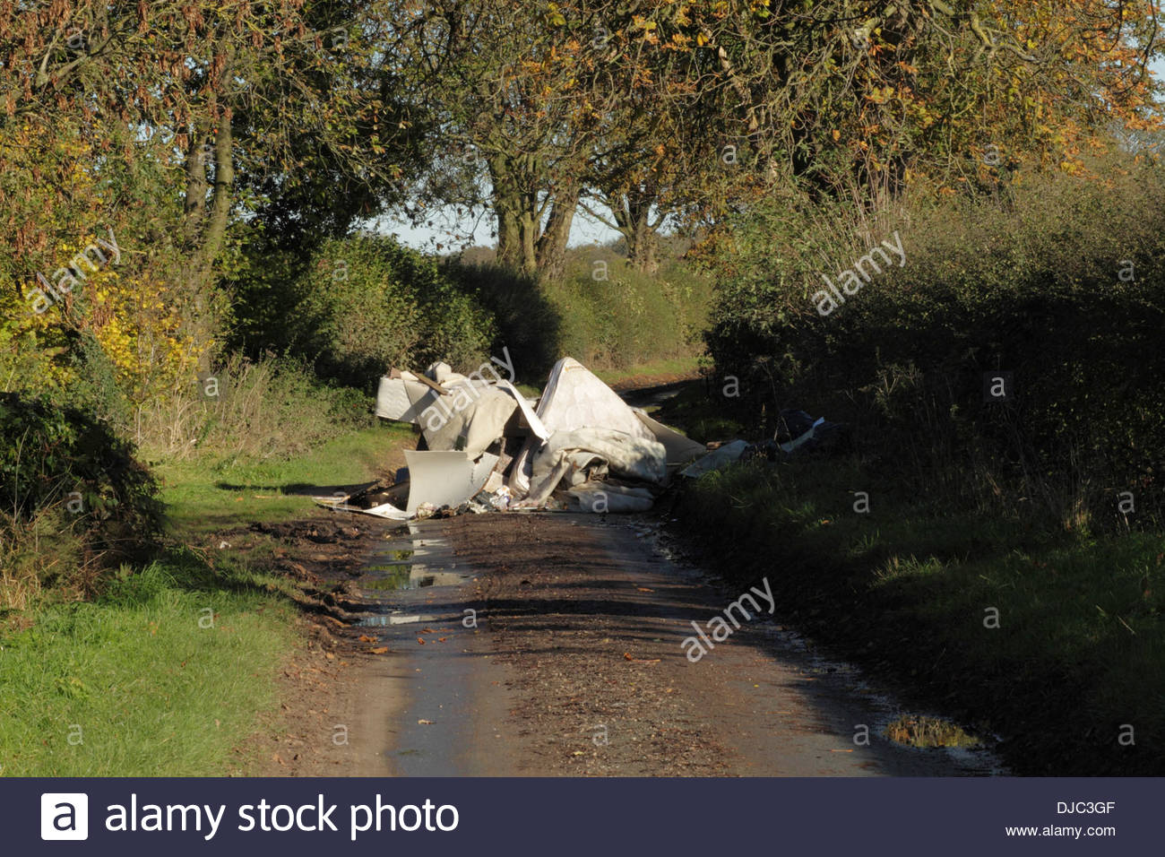 Country Lane Blocked By Fly Tipping Rubbish, Staffordshire, England, UK Stock Photo