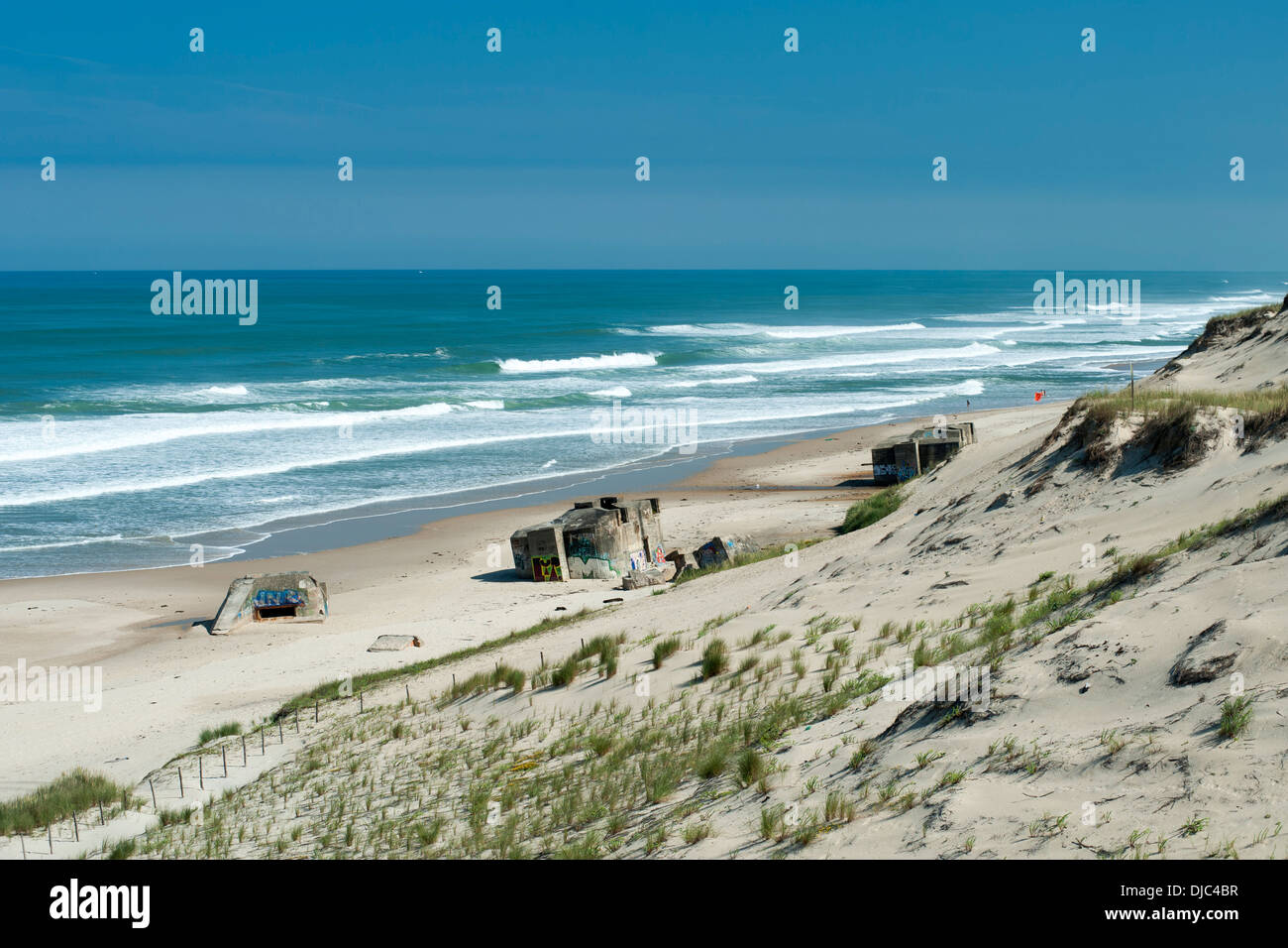 The remains of World War II blockhouses on Le Pin Sec beach in the Aquitaine region of southwestern France. - Stock Image