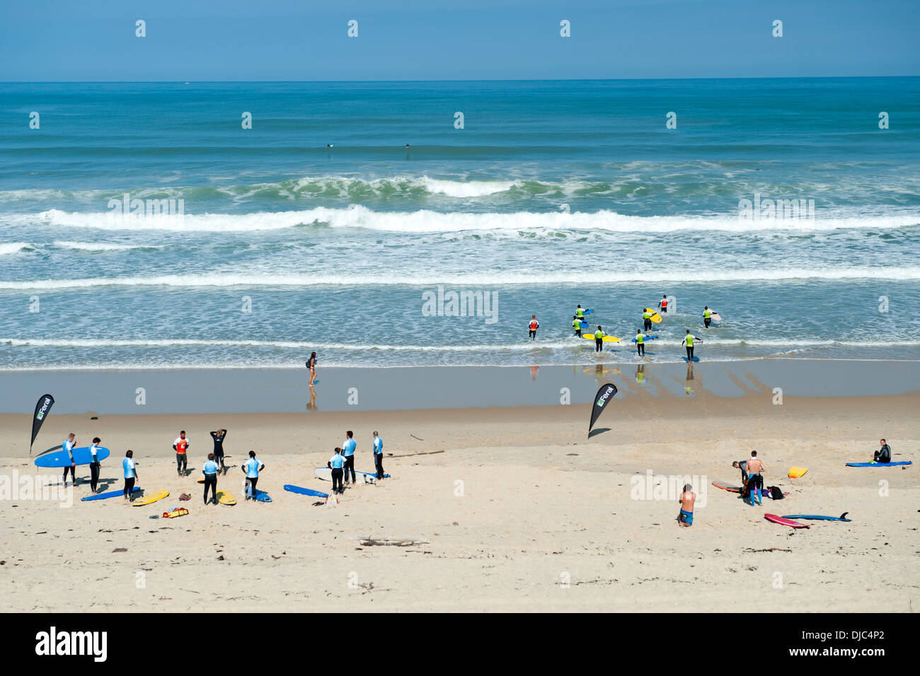 Surfers taking lessons on Le Pin Sec beach in the Gironde department of the Aquitaine region of southwestern France. - Stock Image