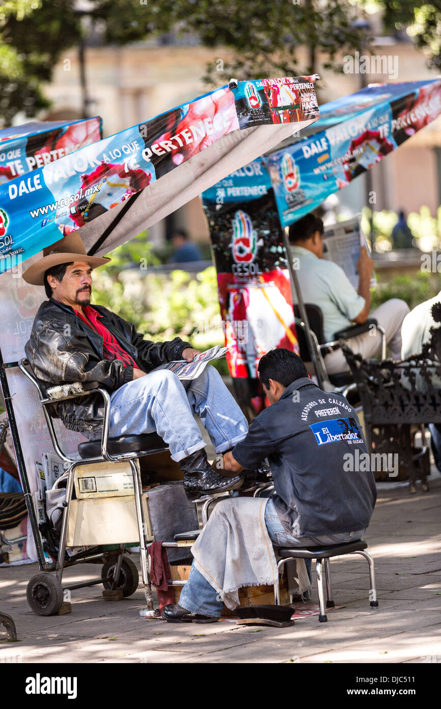 Shoe shine stands in the historic Zocalo or plaza in Oaxaca, Mexico. - Stock Image