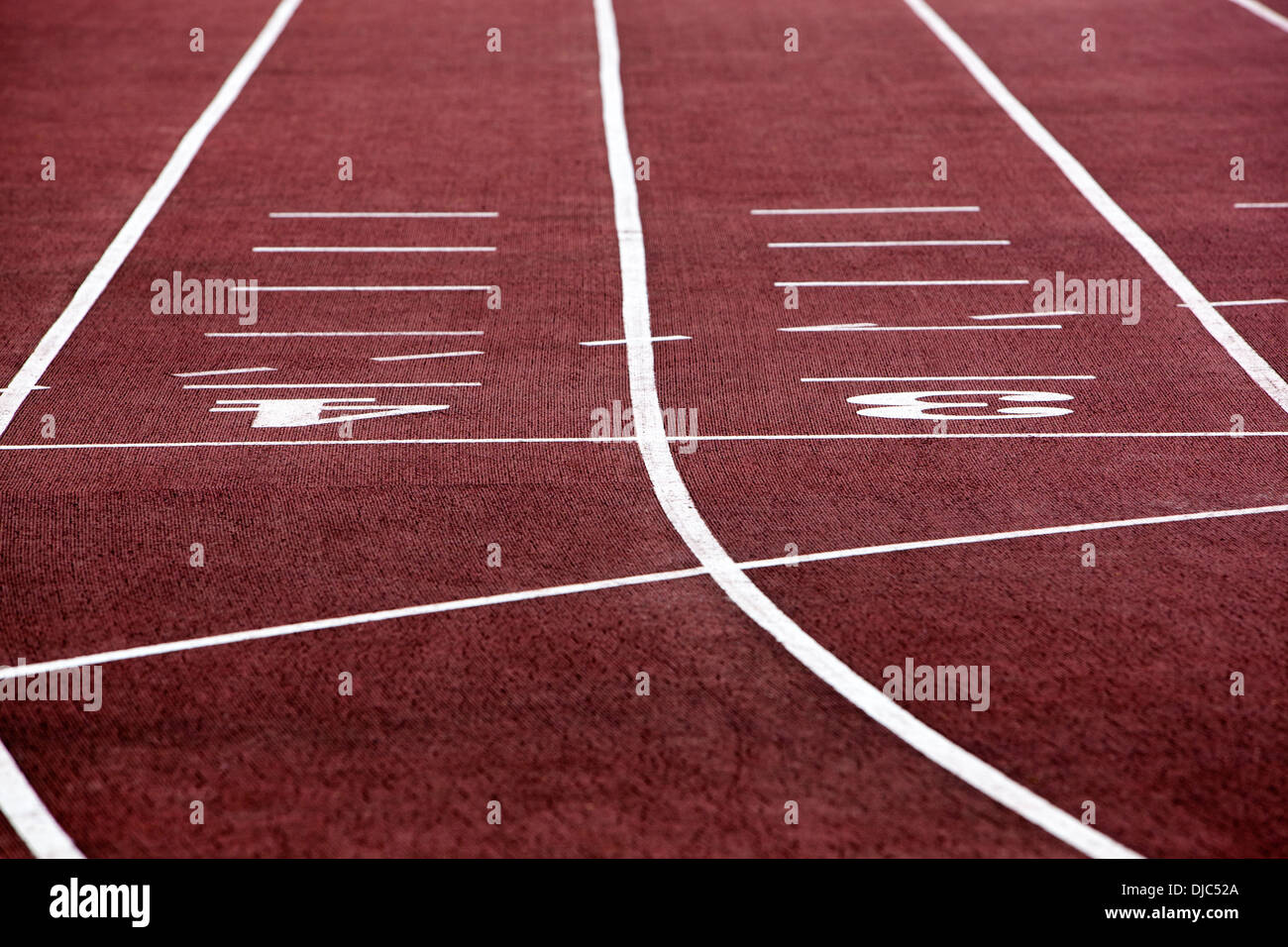 Selective focus on athletics track lane numbers - Stock Image