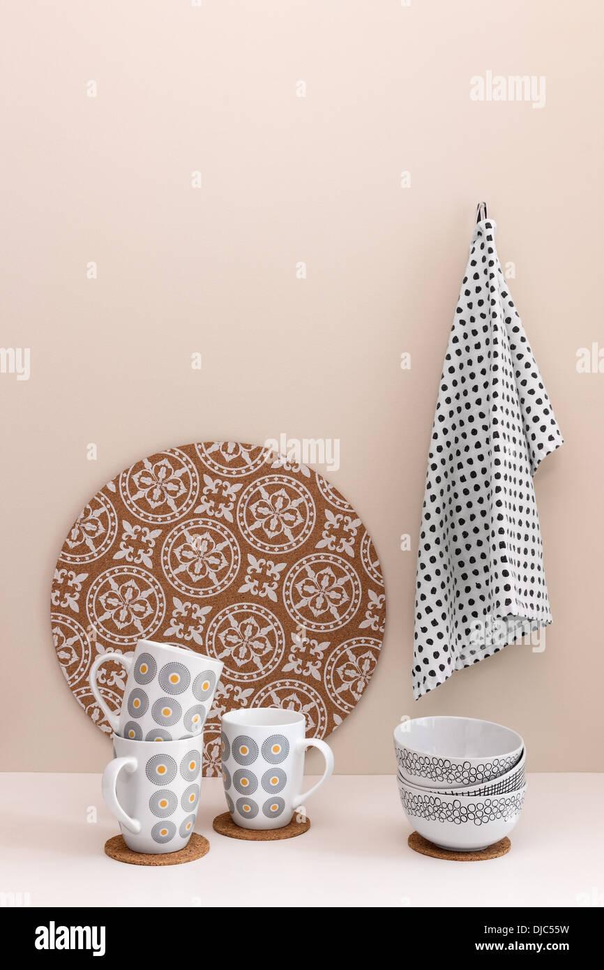 Stylish kitchen utensils. Cups, bowl, kitchen towel. - Stock Image