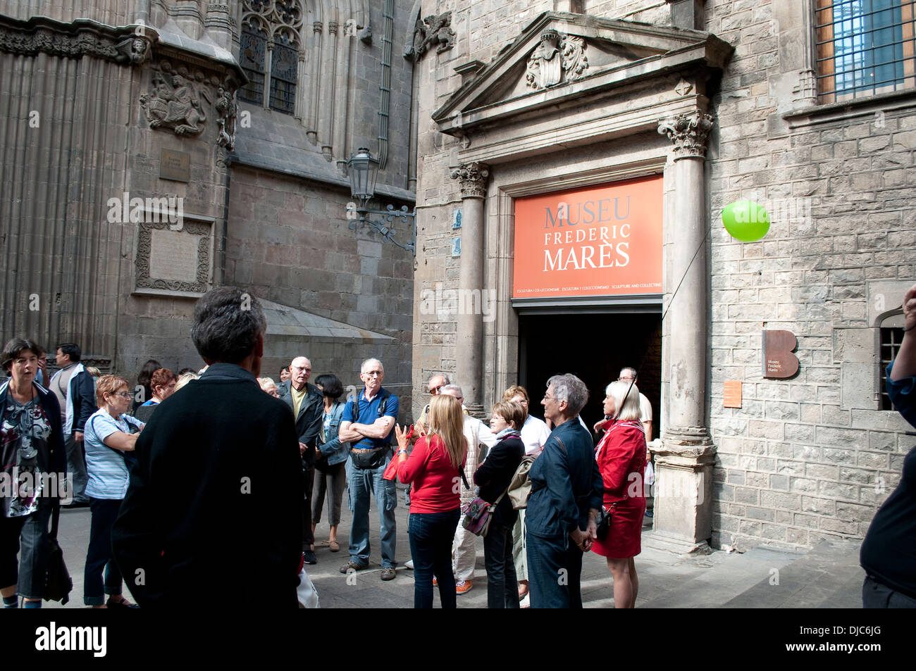 Group of tourists in front of Frederic Mares Museum, Barcelona, Spain - Stock Image