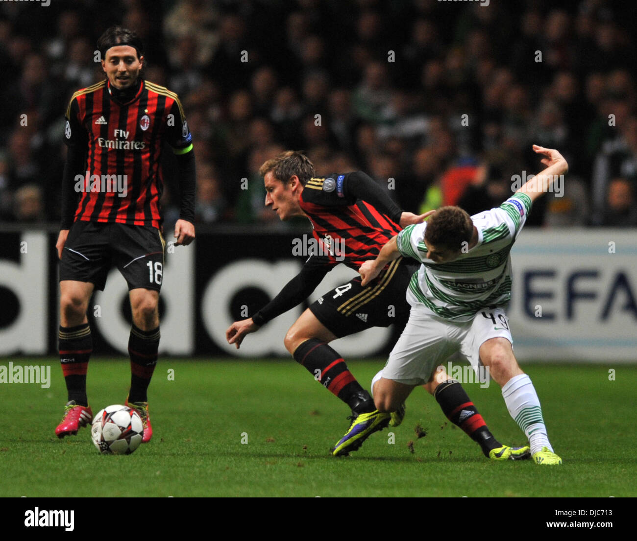 Glasgow, Scotland. 26th Nov, 2013. James Forrest looses out in this challenge during the UEFA Champions League Group H, game between Celtic FC and AC Milan. From Celtic Park Stadium, Glasgow. Credit:  Action Plus Sports/Alamy Live News - Stock Image